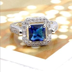 Jewelry - Princess cut blue and white sterling silver ring